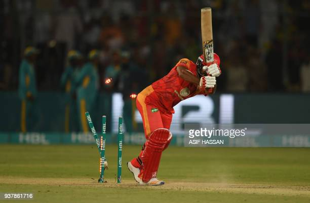Hussain Talat of Islamabad United is clean bowled by Wahab Riaz of Pashawar Zalmi during the Pakistan Super League final match between Peshawar Zalmi...