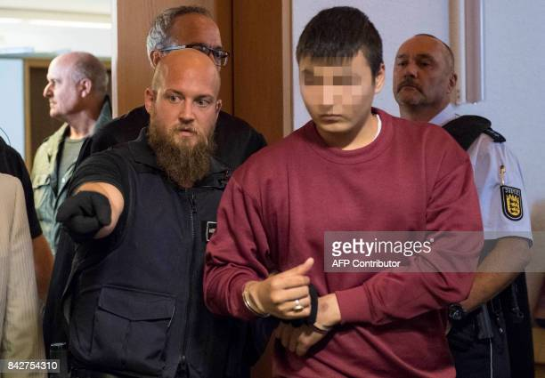 Husseen K who is accused of raping and killing a young woman in October 2016 enters the court room at the regional court in Freiburg southern Germany...