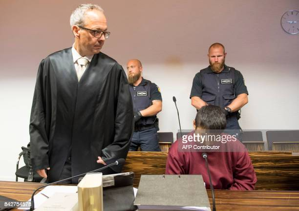 Husseen K who is accused of raping and killing a young woman in October 2016 and his lawyer Sebastian Glathe wait at the court room at the regional...