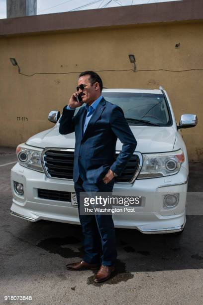 Hussein al Rashid the CEO of a contracting firm talks on his phone at his office on February 8 2018 in Baghdad Iraq Al Rashid is one of many Iraqis...