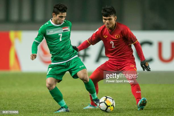 Hussein Ali of Iraq fights for the ball with Pham Xuan Manh of Vietnam during the AFC U23 Championship China 2018 Quarterfinals match between Iraq...