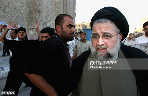 Hussein al-Sadr , the head of a delegation of members of the Iraqi National Conference, walks towards the Shrine of Imam Ali to meet with clerics...