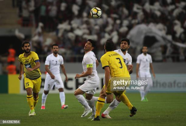 Hussein alSaedi of AlZawraa vies against Khalil Khamis of AlAhed during the AFC Cup football match between Iraq's AlZawraa club and Lebanon's AlAhed...