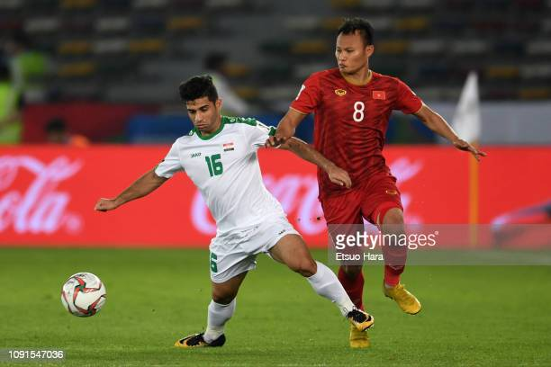 Hussein AlSaedi of Iraq and Nguyen Trong Hoang of Vietnam compete for the ball during the AFC Asian Cup Group D match between Iraq and Vietnam at...