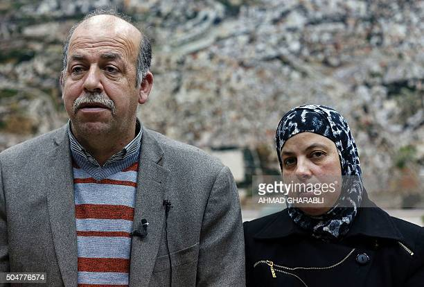 Hussein and Suha the parents of late Palestinian teenager Mohammed Abu Khdeir talk with their lawyer Mohannad Gbara in a courtroom at a Jerusalem...
