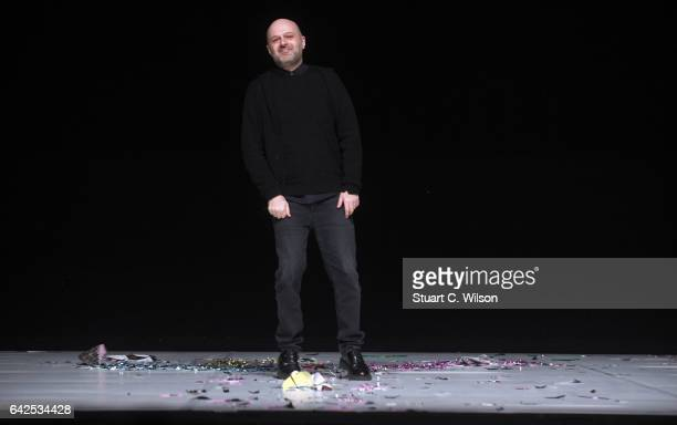 Hussein Chalayan greets guests following his show 'Chalayan' during London Fashion Week February 2017 collections on February 18 2017 in London...