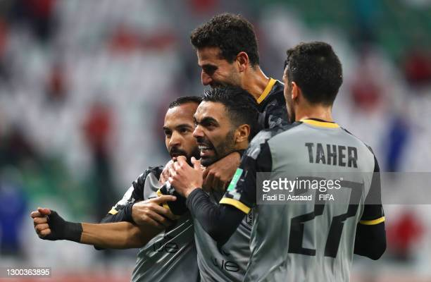 Hussein El Shahat of Al Ahly SC celebrates with teammates Afsha, Hamdi Fathi and Taher Mohamed after scoring their team's first goal during the FIFA...