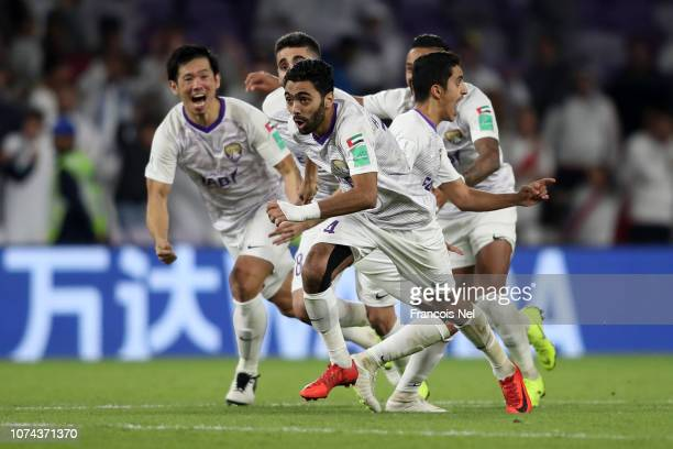 Hussein El Shahat of Al Ain and his team mates celebrates after winning the penalty shootout during the FIFA Club World Cup UAE 2018 Semi Final Match...