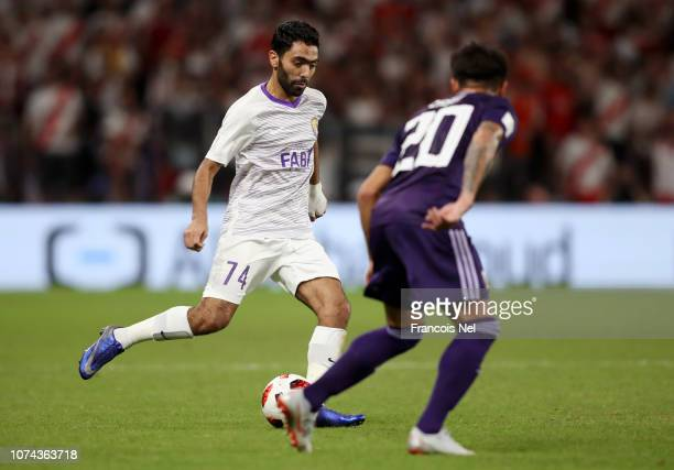 Hussein El Shahat of Al Ain is challenged by Milton Casco of River Plate during the FIFA Club World Cup UAE 2018 Semi Final Match between River Plate...