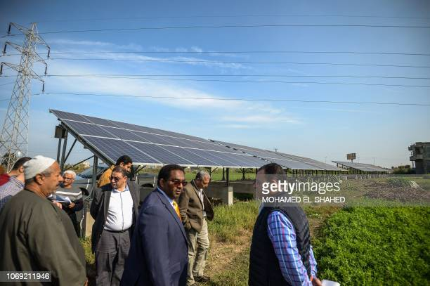 Hussein Gadain UN's Food and Agriculture Organization representative checks the solar pannels with farmers in Kafr alDawar village in northern...
