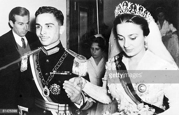 Hussein Ibn Talal, King of Jordan holds hand of his first bride, Princess Dina, daughter of Prince Abdel-Hamid Aoun of Hijaz, during their wedding 22...