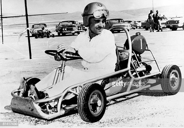 Hussein Ibn Talal King of Jordan wearing a helmet on the wheel on his kart 31 May 1962 in Amman