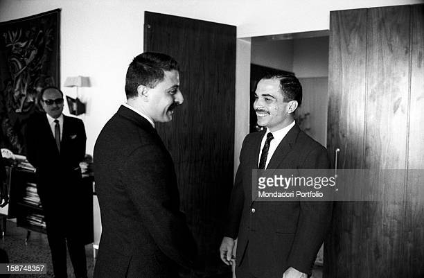 Hussein of Jordan talking with the Italian journalist Giorgio Torelli copy editor for Grazia Jordan 24th March 1964