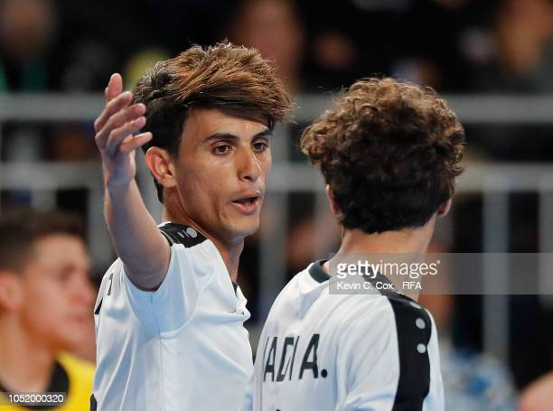 Hussein Sabri of Iraq celebrates scoring the second goal against Argentina with Hadi Alaa in the Men's Futsal Group A match between Argentina and...