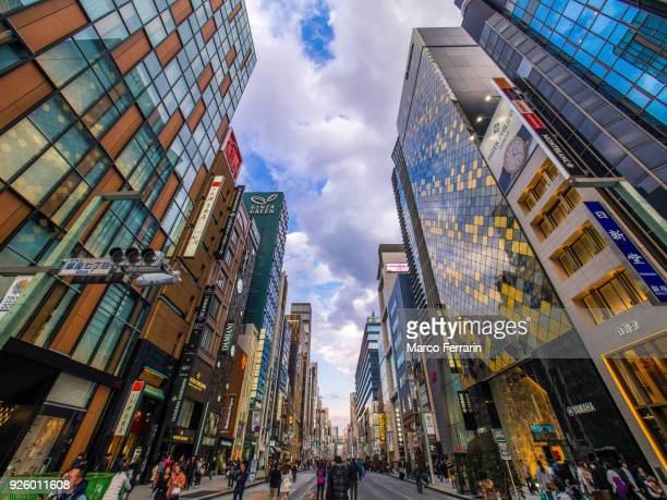 Hustle and Bustle of the Luxury Shopping Streets on Sunday, Ginza Avenue Lined with Shops of Expensive Brands in the Heart of Tokyo, Japan