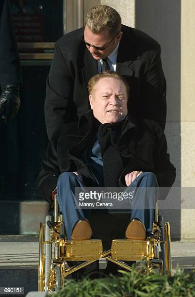 Hustler magazine Publisher Larry Flynt leaves District Court January 4 2002 in Washington DC Flynt is suing Defense Secretary Donald Rumsfeld and the...