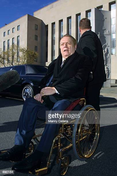 Hustler magazine Publisher Larry Flynt talks to the press January 4 2002 outside the District Court in Washington DC Flynt is suing Defense Secretary...