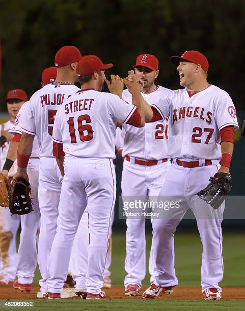 Huston Street and Mike Trout of the Los Angeles Angels of Anaheim highfive while celebrating after Street threw his 300th career save to defeat the...