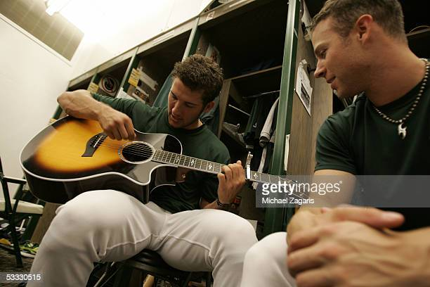Huston Street and Rich Harden of the Oakland Athletics practice the guitar in the clubhouse before the game against the Texas Rangers at McAfee...