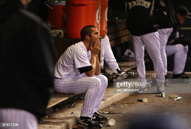 Huston Street of the Colorado Rockies sits dejected in the dugout after the loss against the Philadelphia Phillies in Game Four of the NLDS during...