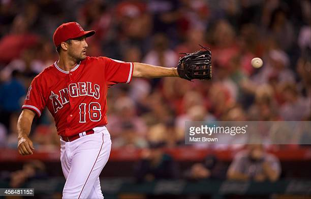 Huston Street of the Los Angeles Angels of Anaheim catches the ball during the game against the Seattle Mariners on July 19 2014 at Angel Stadium of...