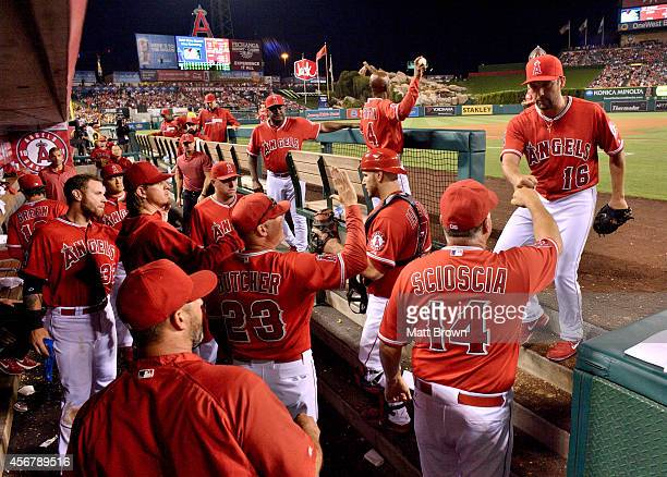 Huston Street of the Los Angeles Angels of Anaheim celebrates with manager Mike Scioscia during the game against the Oakland Athletics on July 19...