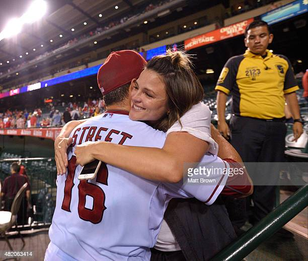 Huston Street of the Los Angeles Angels of Anaheim hugs his wife Lacey Street while celebrating after he threw his 300th career save to defeat the...