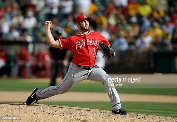 Huston Street of the Los Angeles Angels of Anaheim pitches against the Oakland Athletics at Oco Coliseum on September 24 2014 in Oakland California