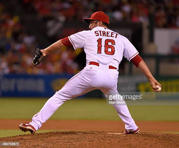 Huston Street of the Los Angeles Angels of Anaheim pitches during the ninth inning of the game against the Seattle Mariners at Angel Stadium of...