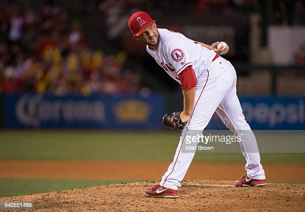 Huston Street of the Los Angeles Angels of Anaheim pitches during the ninth inning of the game against the Cleveland Indians at Angel Stadium of...