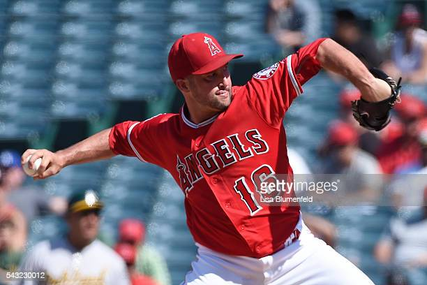 Huston Street of the Los Angeles Angels of Anaheim pitches in the ninth inning against the Oakland Athletics at Angel Stadium of Anaheim on June 26...