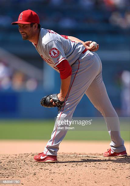 Huston Street of the Los Angeles Angels of Anaheim prepares to pitch during the eighth inning of the game against the Los Angeles Dodgers at Dodger...