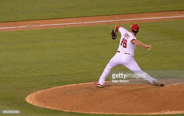 Huston Street of the Los Angeles Angels of Anaheim throws the final pitch of his 300th career save during the ninth inning of the game against the...