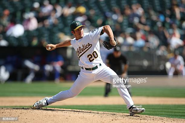 Huston Street of the Oakland Athletics pitches during the game against the Texas Rangers at the McAfee Coliseum in Oakland California on September 13...