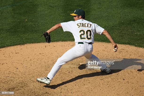 Huston Street of the Oakland Athletics pitches during the game against the Texas Rangers at the McAfee Coliseum in Oakland California on September 14...