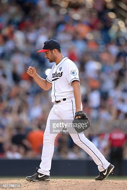 Huston Street of the San Diego Padres celebrates the final out in the game against the San Francisco Giants at Petco Park on July 4 2014 in San Diego...
