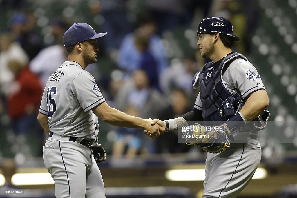 Huston Street #16 of the San Diego Padres celebrates with Yasamani Grandal #8 after the 2-1 win over the Milwaukee Brewers at Miller Park on April 22, 2014 in Milwaukee, Wisconsin.