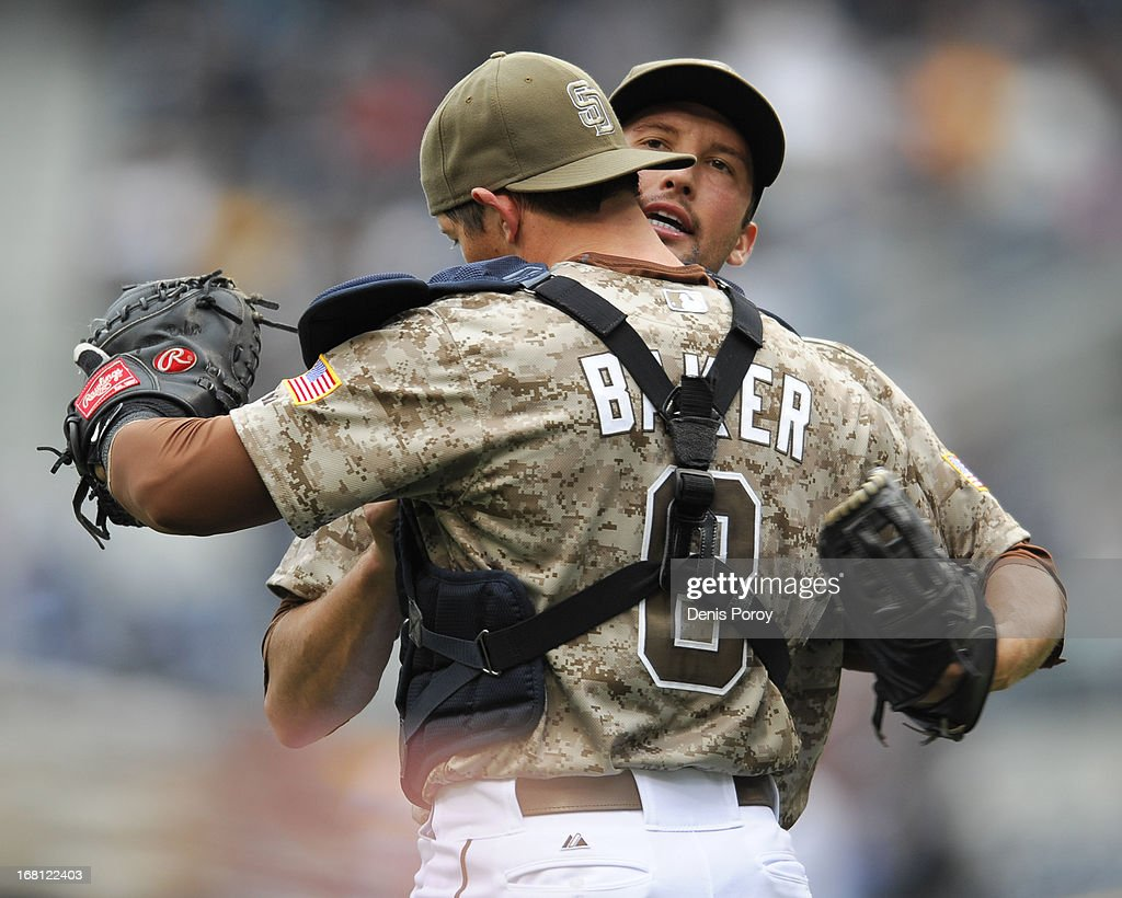 Huston Street #16 of the San Diego Padres is congratulated by John Baker #8 of the San Diego Padres after getting the final out in the ninth inning of a baseball game against the Arizona Diamondbacks at Petco Park on May 5, 2013 in San Diego, California. The Padres won 5-1.