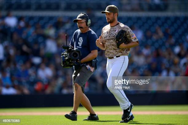 Huston Street of the San Diego Padres jogs to the mound in the ninth inning of the game against the Miami Marlins at Petco Park on May 11 2014 in San...