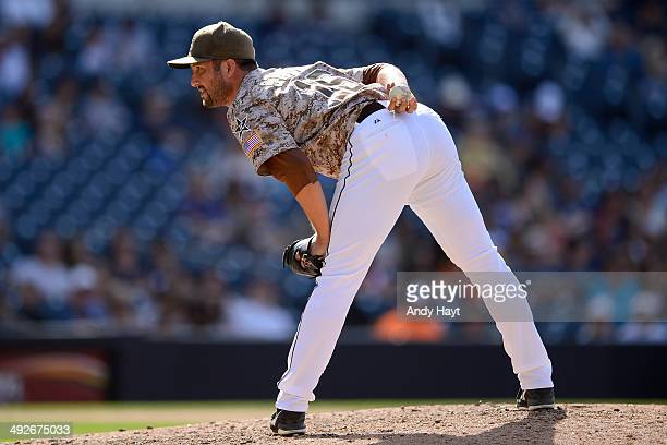 Huston Street of the San Diego Padres looks for the catchers pitch call in the ninth inning of the game against the Miami Marlins at Petco Park on...