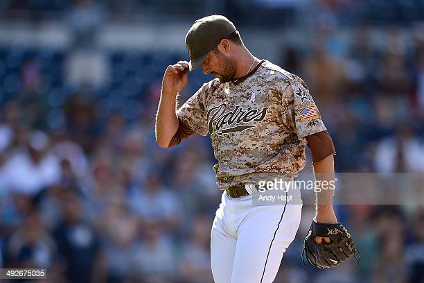 Huston Street of the San Diego Padres tugs at his cap in the ninth inning of the game against the Miami Marlins at Petco Park on May 11 2014 in San...