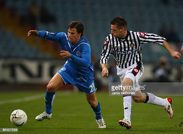 Huszti of Zenit StPetersburgh battles with Giovanni Pasquale of Udinese during the UEFA Cup last of 16 first leg match between Udinese and Zenit...
