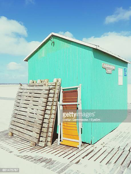 Hut At Beach Against Sky