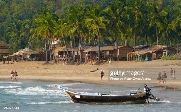 Hut bars and coconut trees in Agonda beach, South Goa, India