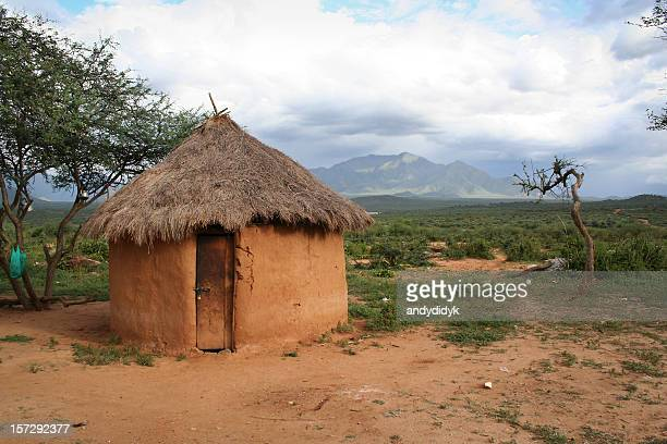 a hut made out of mud in africa  - hut stock pictures, royalty-free photos & images