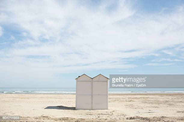 Hut On Beach Against Sky