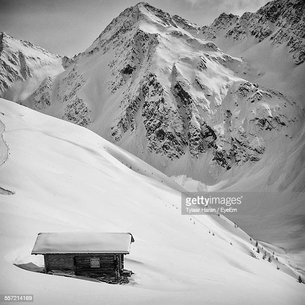 Hut On Snow Covered Mountain