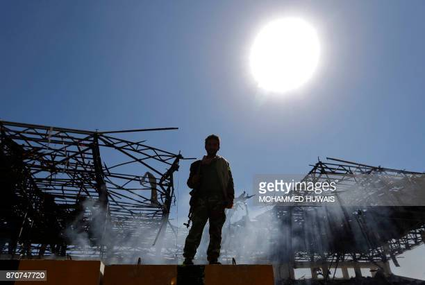 A Houthi fighter inspects the site of an air strike in the Yemeni capital Sanaa on November 5 2017 Yemen's rebelheld capital was struck by overnight...