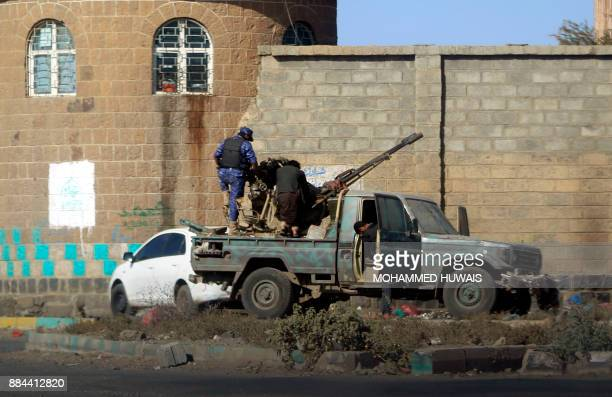 Huthi fighters man an antiaircraft gun in the Yemeni capital Sanaa on December 2 during clashes with supporters of Yemeni expresident Ali Abdullah...