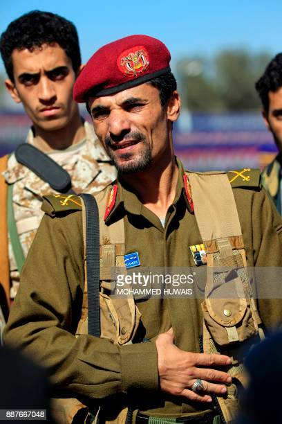 Huthi military commander Abdullah alHakim attends a funeral of victims of recent clashes between Huthi fighters and fighters of the late Yemeni...